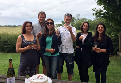 Our team toasting the Type Pro launch with Prosecco and cake