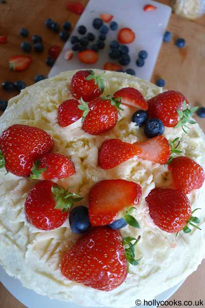 Holly-cooks-lemon-and-blueberry-pinata-cake-strawberries-on-top-web