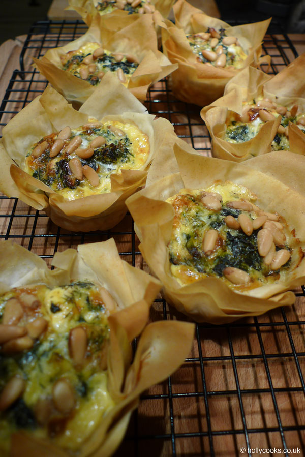 Holly-cooks-spinach-feta-and-pine-nut-tartlets-portraitHolly-cooks-spinach-feta-and-pine-nut-tartlets-portrait