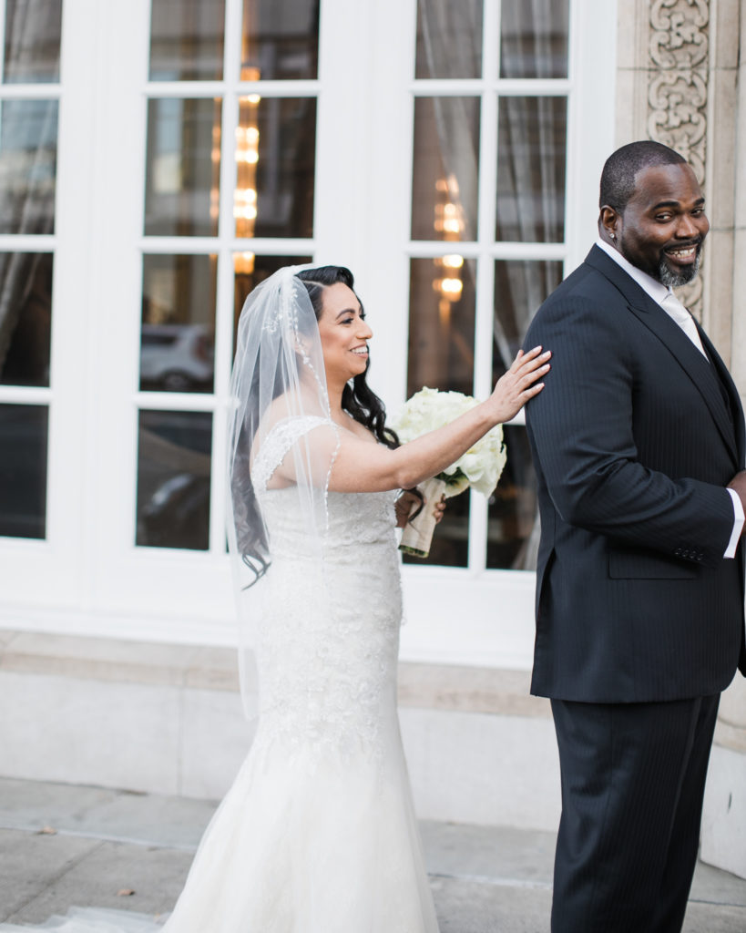 a bride and groom's first look before their wedding at The Westin San Jose