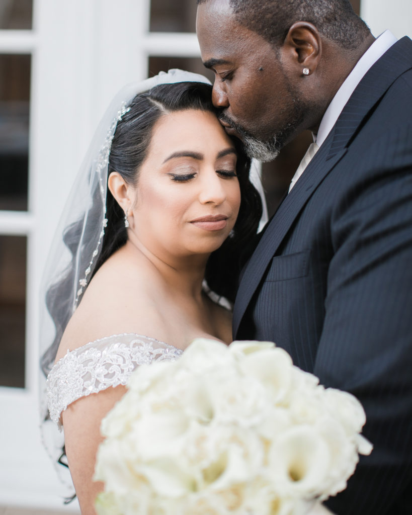 a couple snuggle before their wedding at The Westin San Jose