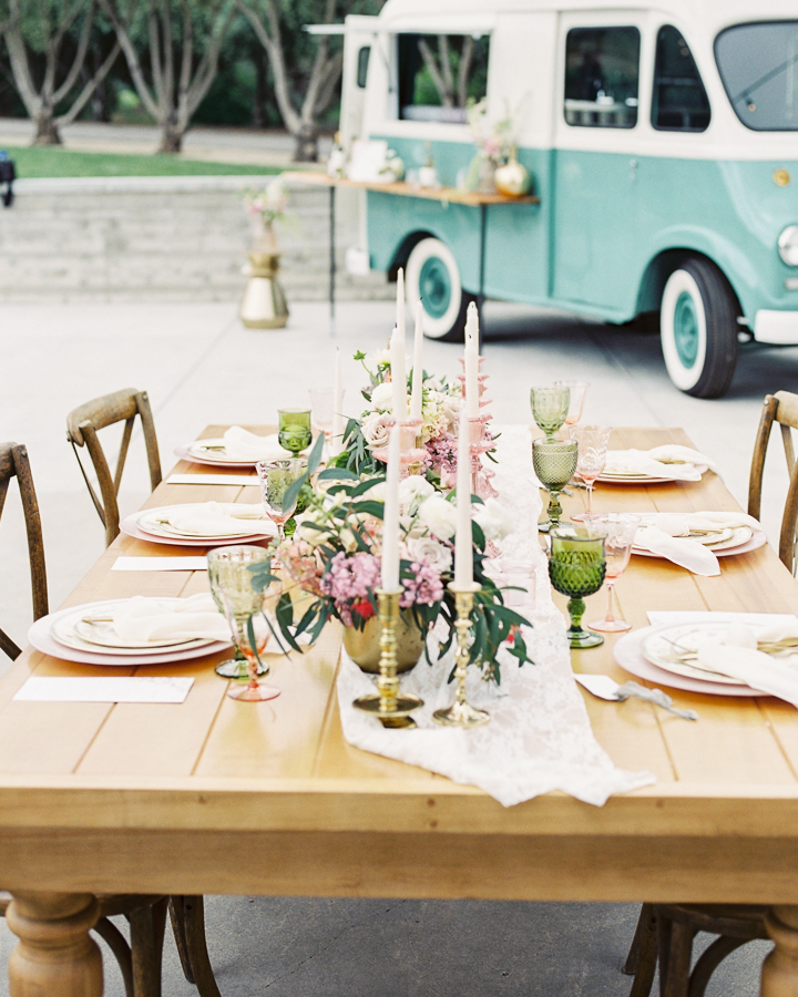 wedding planning tips: a wedding table and place settings with pink and green color palette