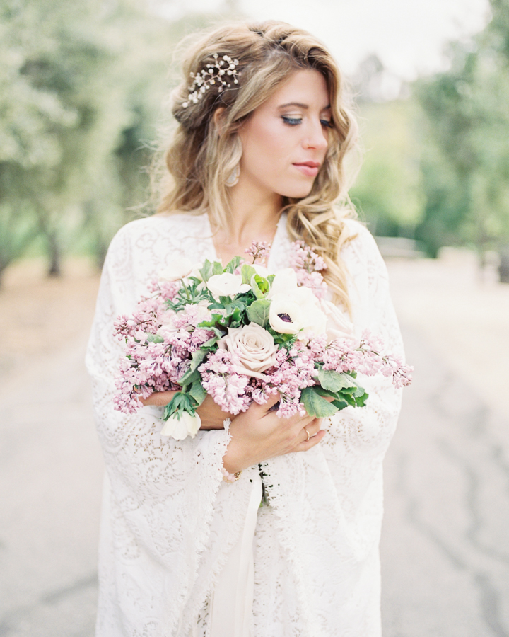 beautiful bride holds her bouquet