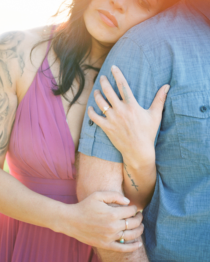 a close up of hands and an engagement ring during engagement photos at Sutro Baths
