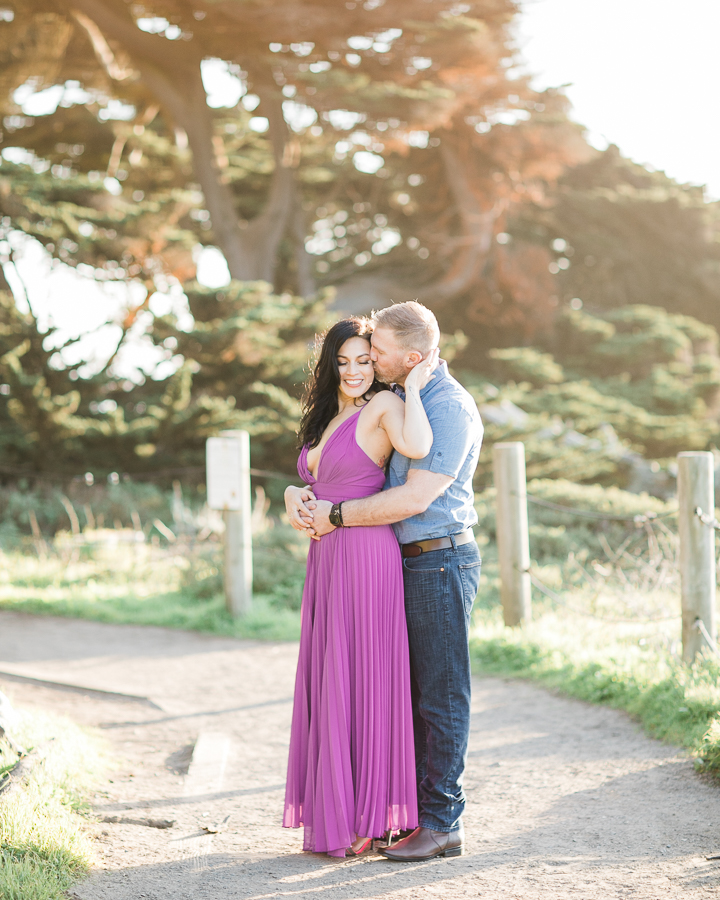 a couple loves each other during engagement photos at Sutro Baths