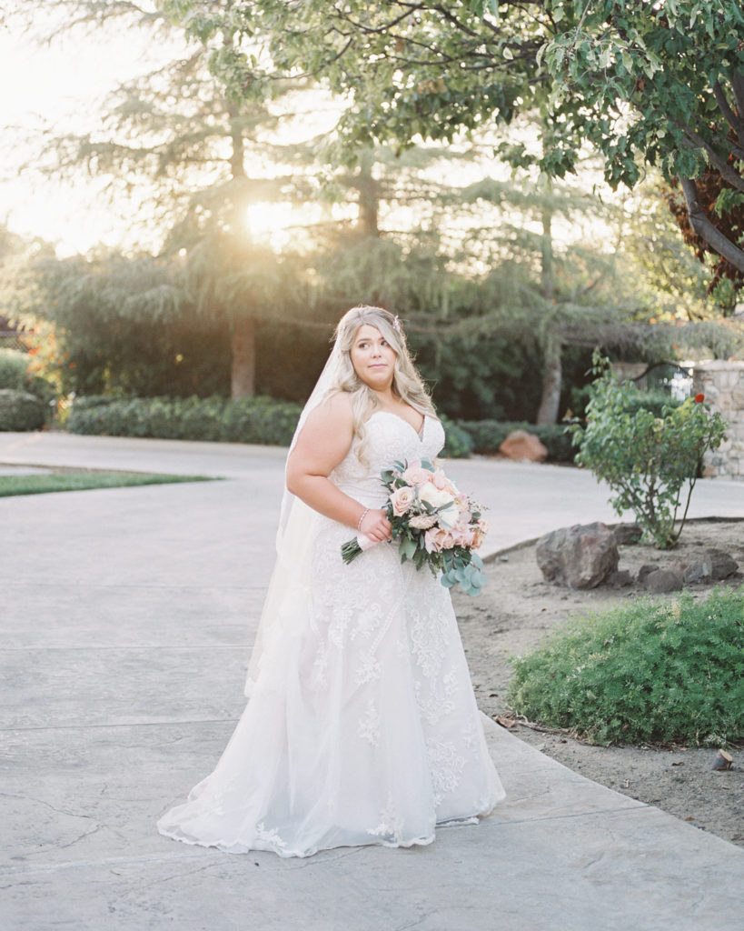 a bride poses for photos during her intimate estate wedding