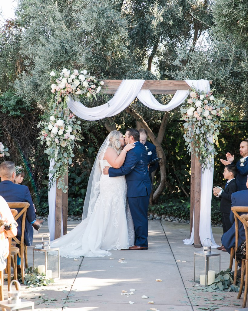 first kiss during an intimate estate wedding ceremony