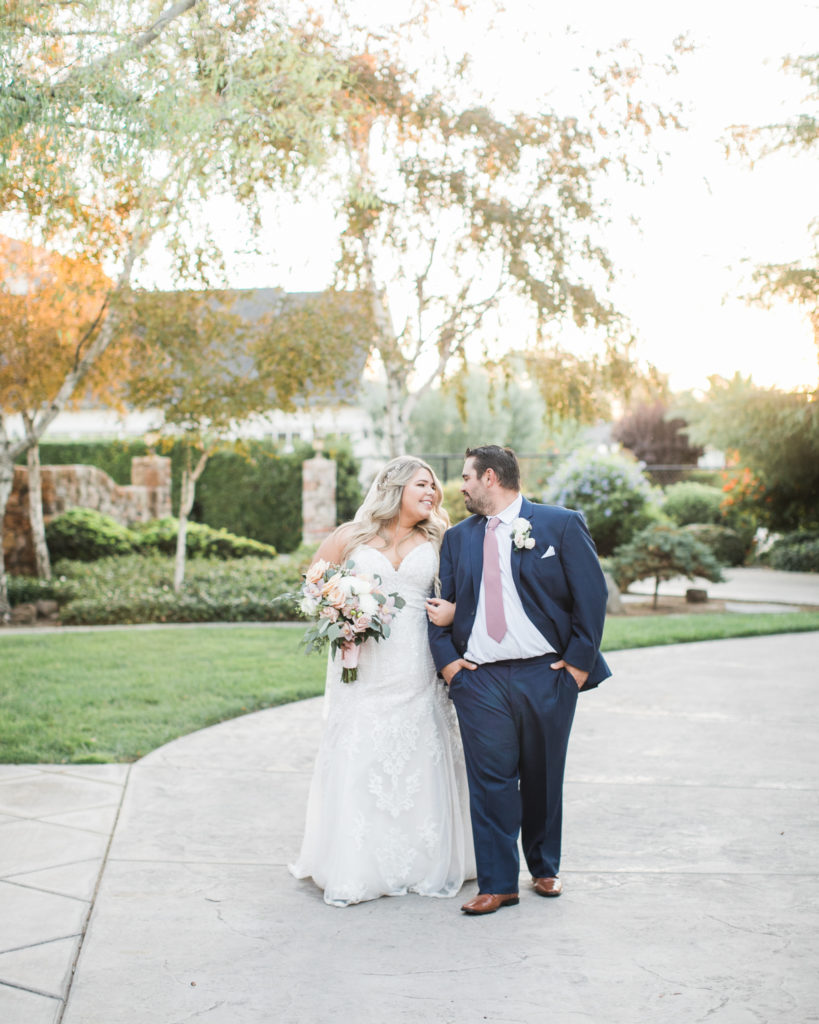 bride and groom walk together during their intimate estate wedding
