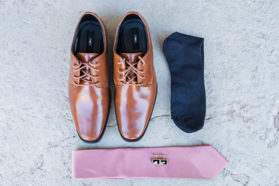 groom's clothing details before his intimate estate wedding