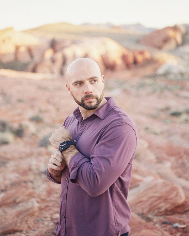 a handsome man during his Valley of Fire engagement session