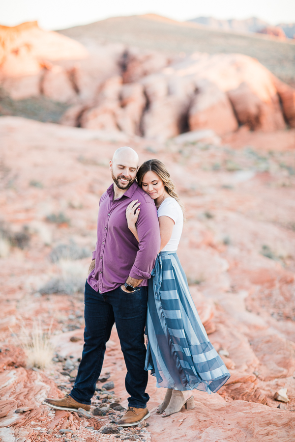 a couple cuddles during Valley of Fire engagement session