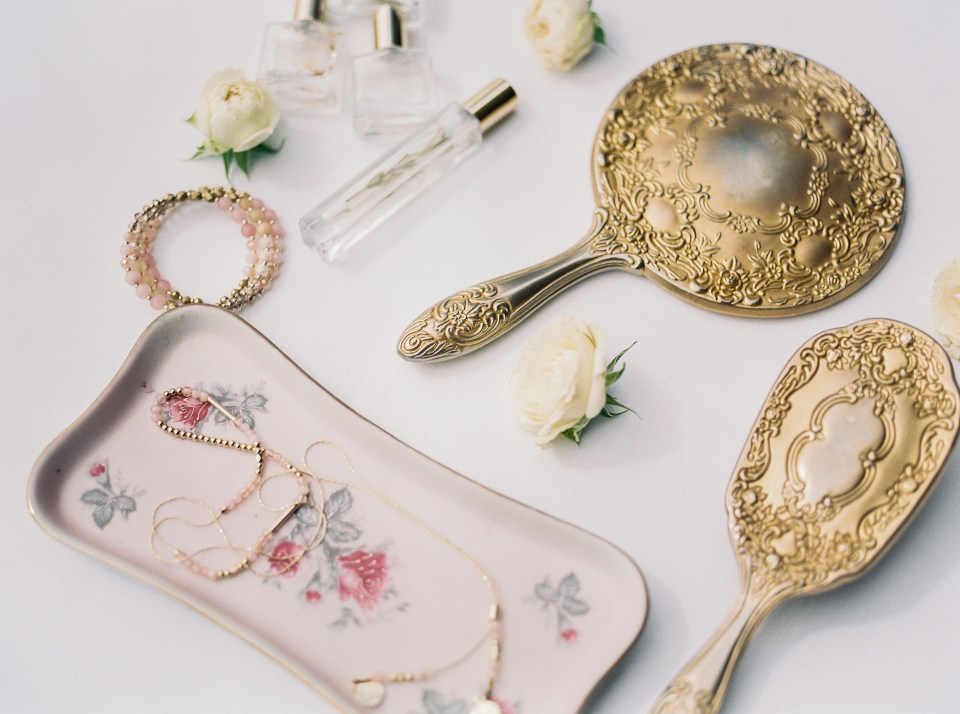vintage mirrors and jewelry trays at a boho wedding