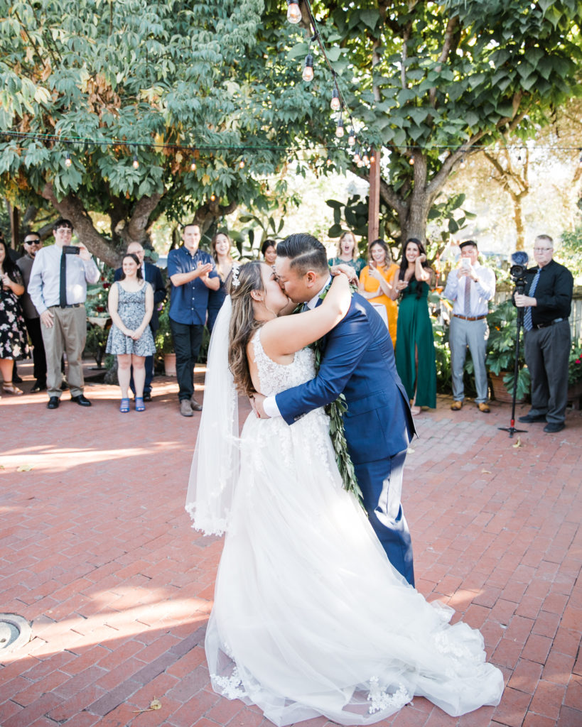 bride and groom share a first dance at their wedding at Jardines de San Juan