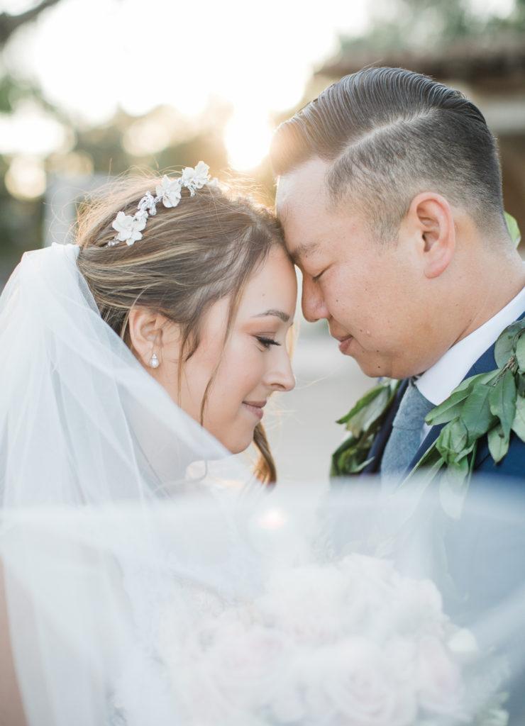 bride and groom posing for photos at wedding at Jardines de San Juan