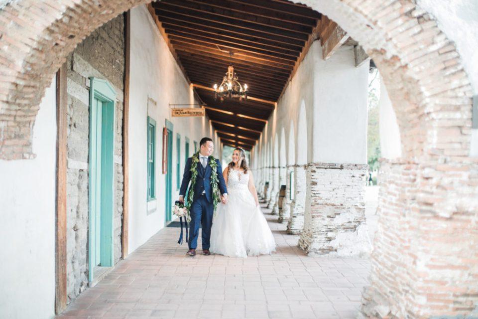 a couple walks the grounds before their wedding at Jardines de San Juan