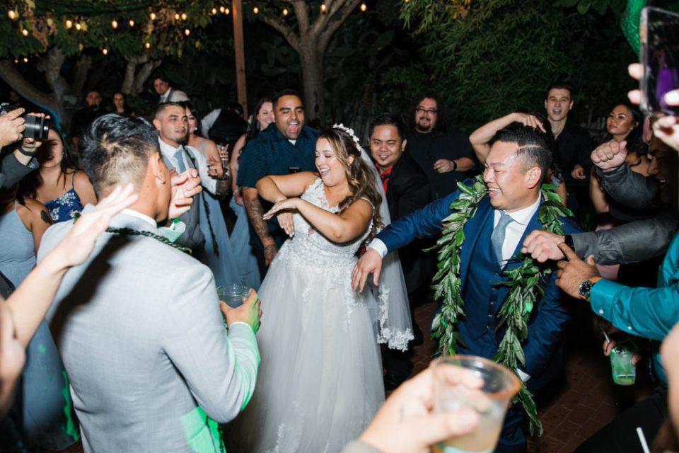people dancing during a wedding reception at Jardines de San Juan