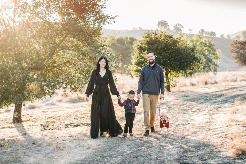 a family walks with their dog family photos at Santa Teresa Park