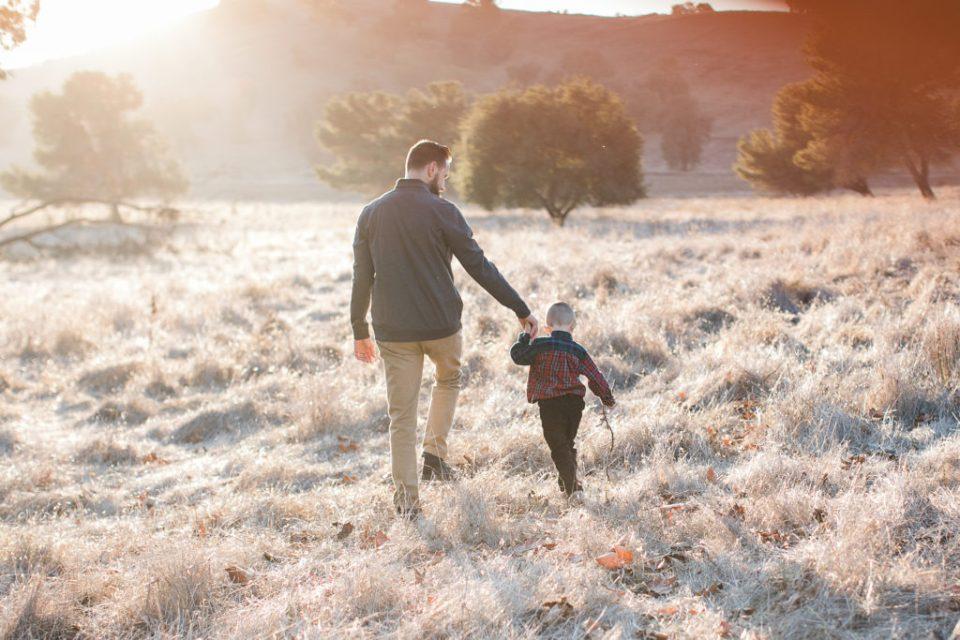 dad and son play during family photos at Santa Teresa Park