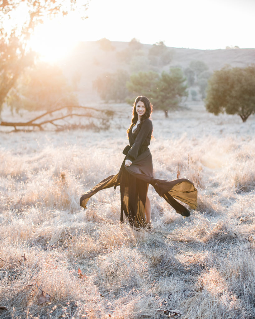 a woman twirls in her dress during family photos at Santa Teresa Park