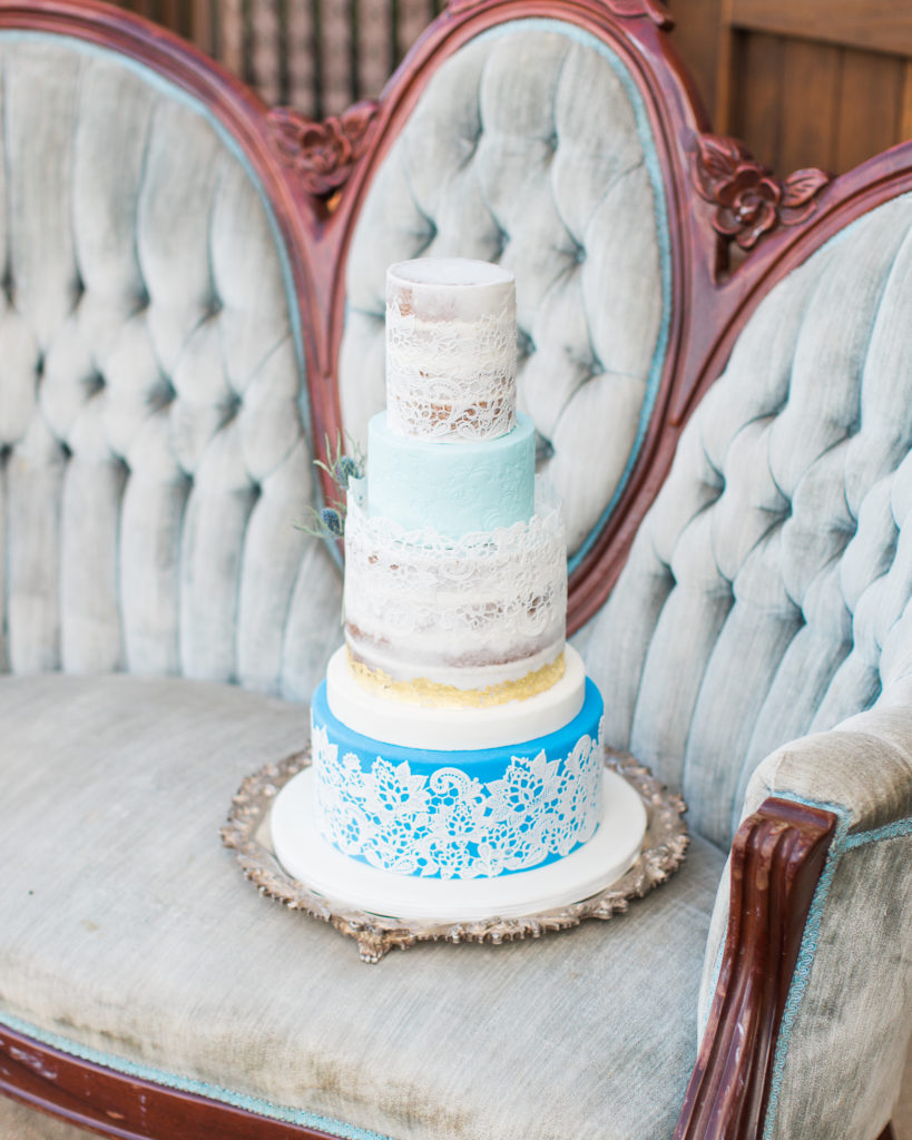 a blue themed wedding cake by Batter Up Bakery