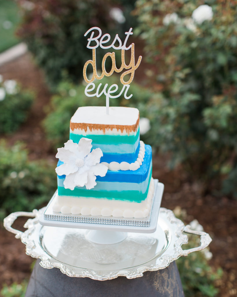 a fun blue and green themed wedding cake by Frank's Cakes