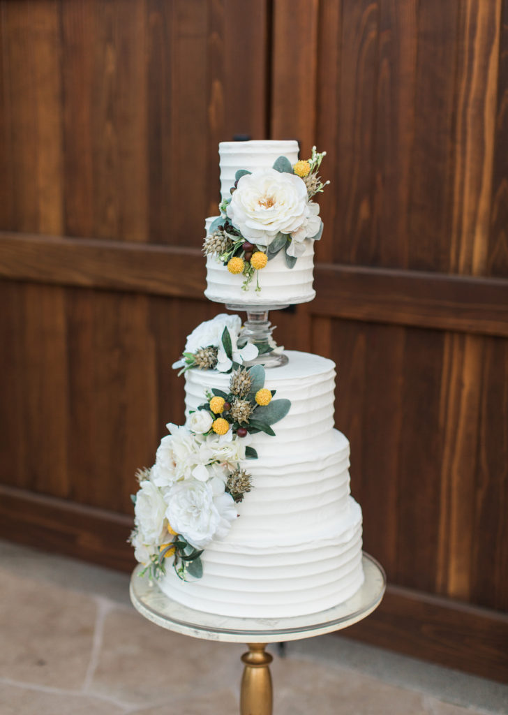 an elegant white and floral wedding cake by Something Sweet Bakery