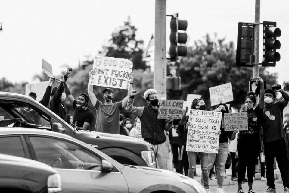protestors at an intersection in Tracy, CA