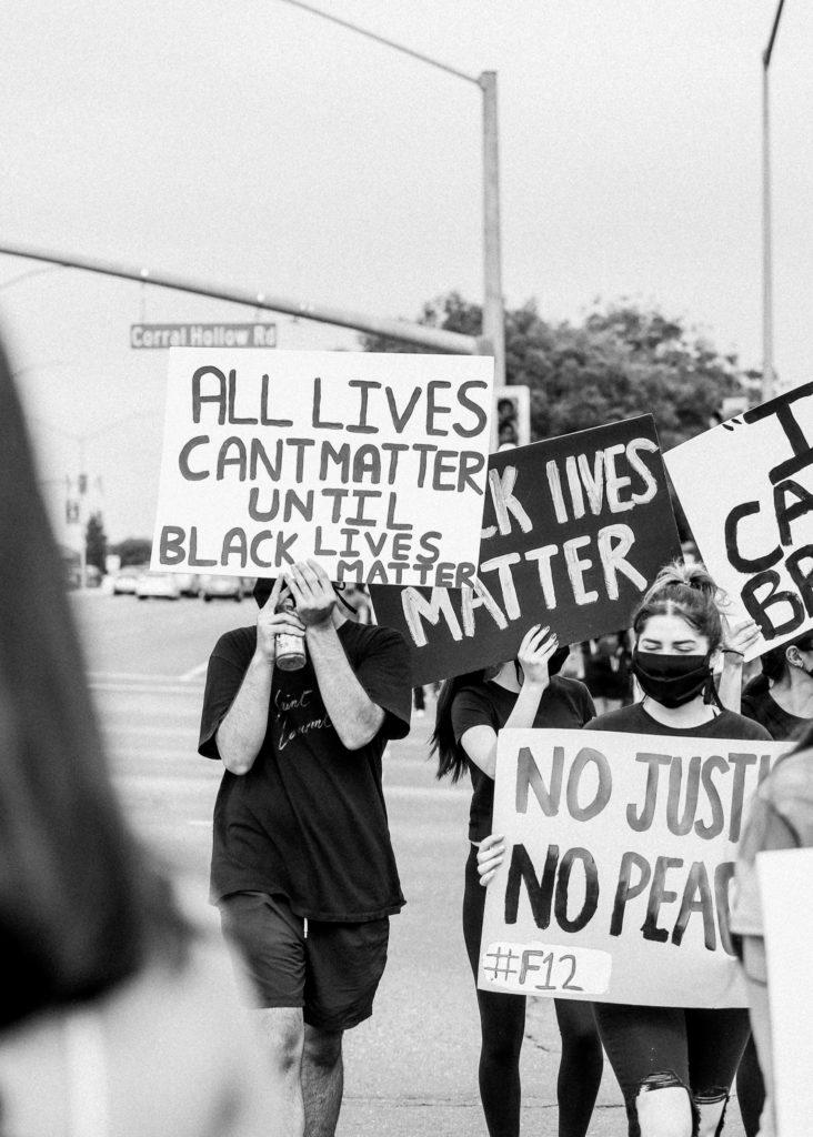 protestors holding sign at black lives matter protest