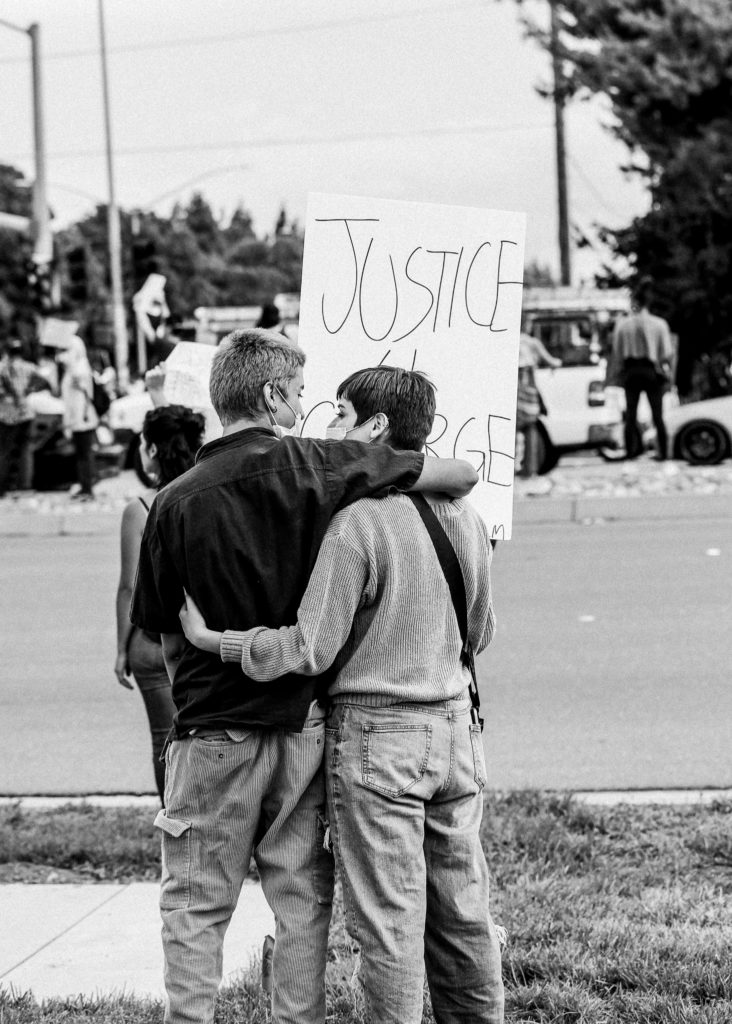 people hugging at a peaceful protest in Tracy, CA