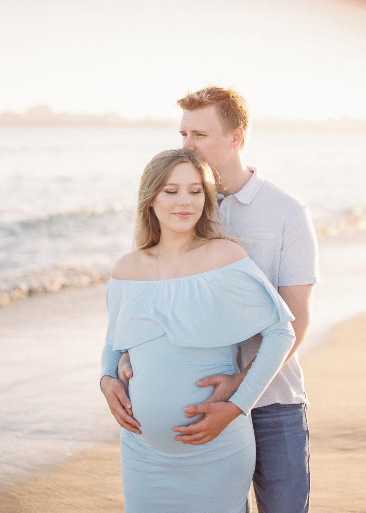 beach maternity photos during golden hour