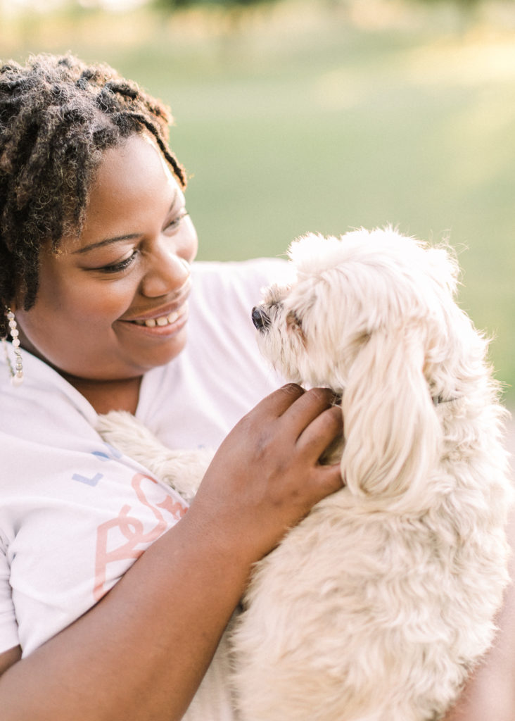 photographer plays with her dog during a Love Myself photoshoot