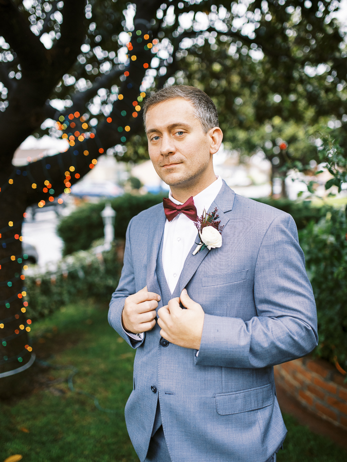 a groom poses for a photo before his Bay Area intimate wedding