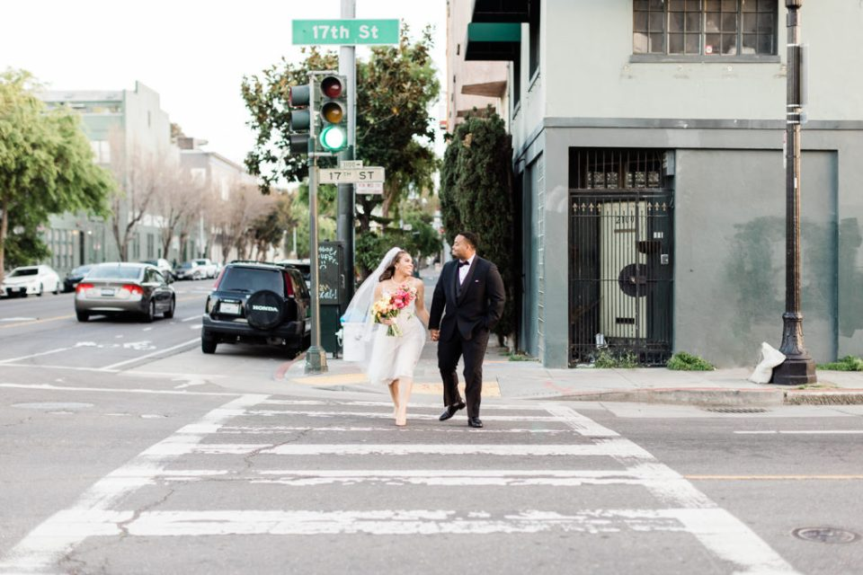 a couple walks across the street after their wedding at Stable Cafe in San Francisco