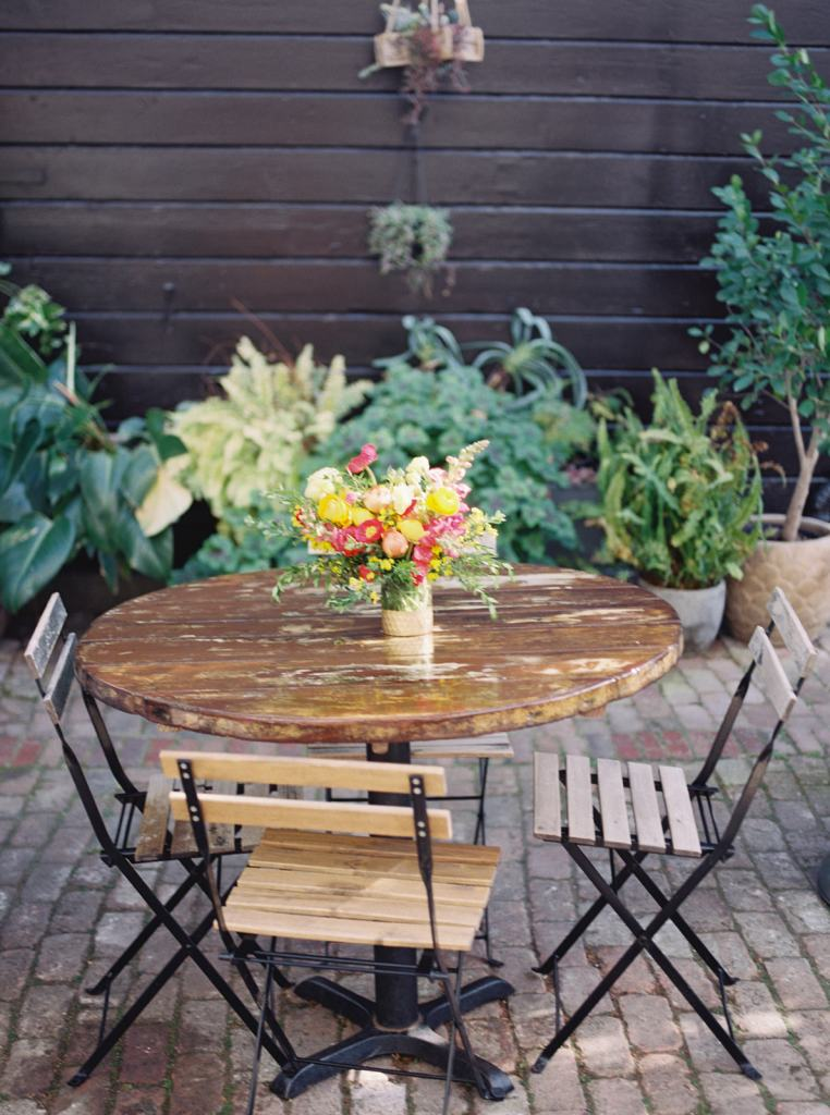 table and chairs with flowers at Stable Cafe in San Francisco