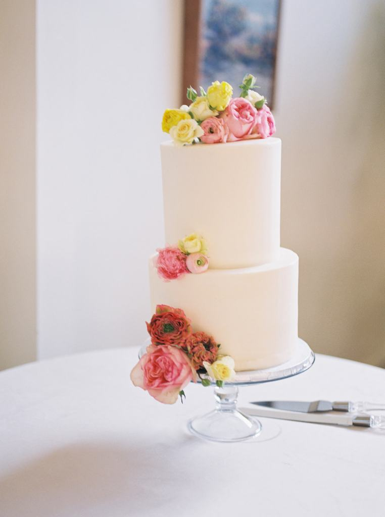 beautiful wedding cake with colorful flowers at Stable Cafe in San Francisco