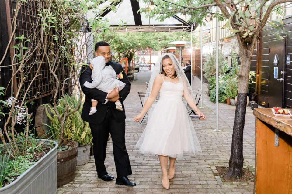 a bride and groom celebrate by dancing up the aisle at Stable Cafe in San Francisco