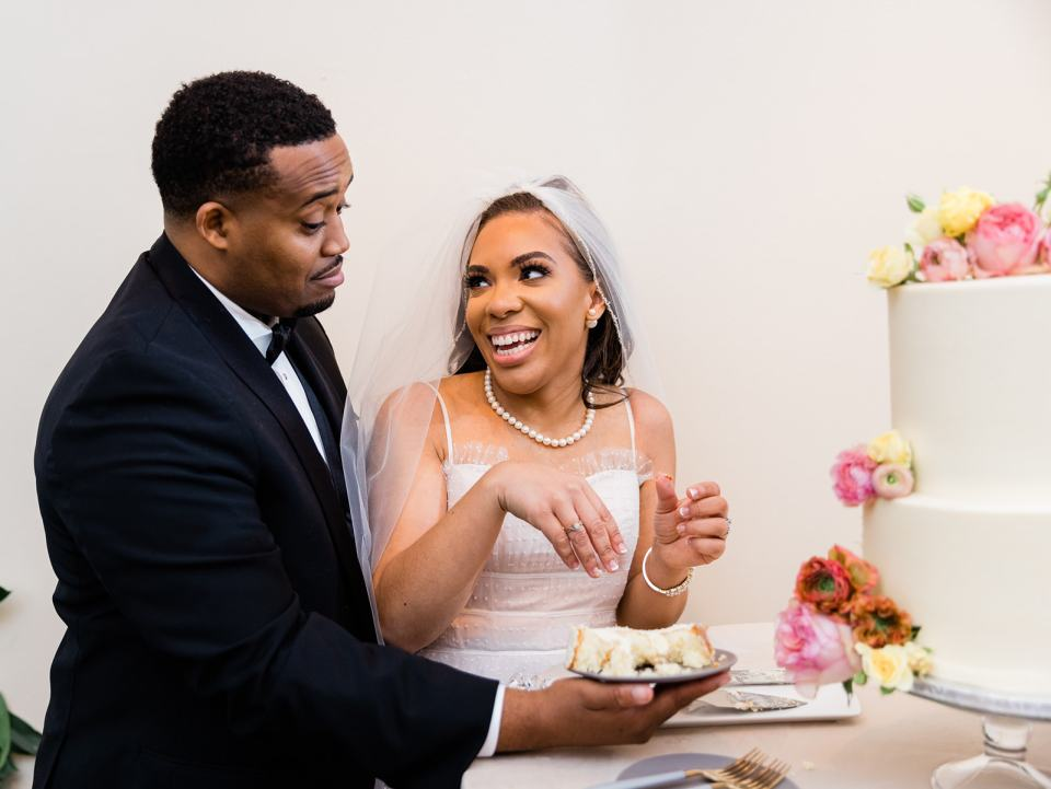 a couple cuts their wedding cake at Stable Cafe in San Francisco