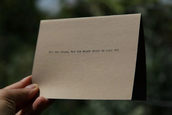 Brown Typewriter Poetry Cards - Front (reads: Not the stars, but the black which we call sky)