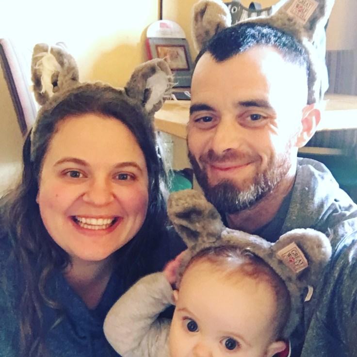 mom dad smiling baby cub wolf ears great wolf lodge sandusky ohio