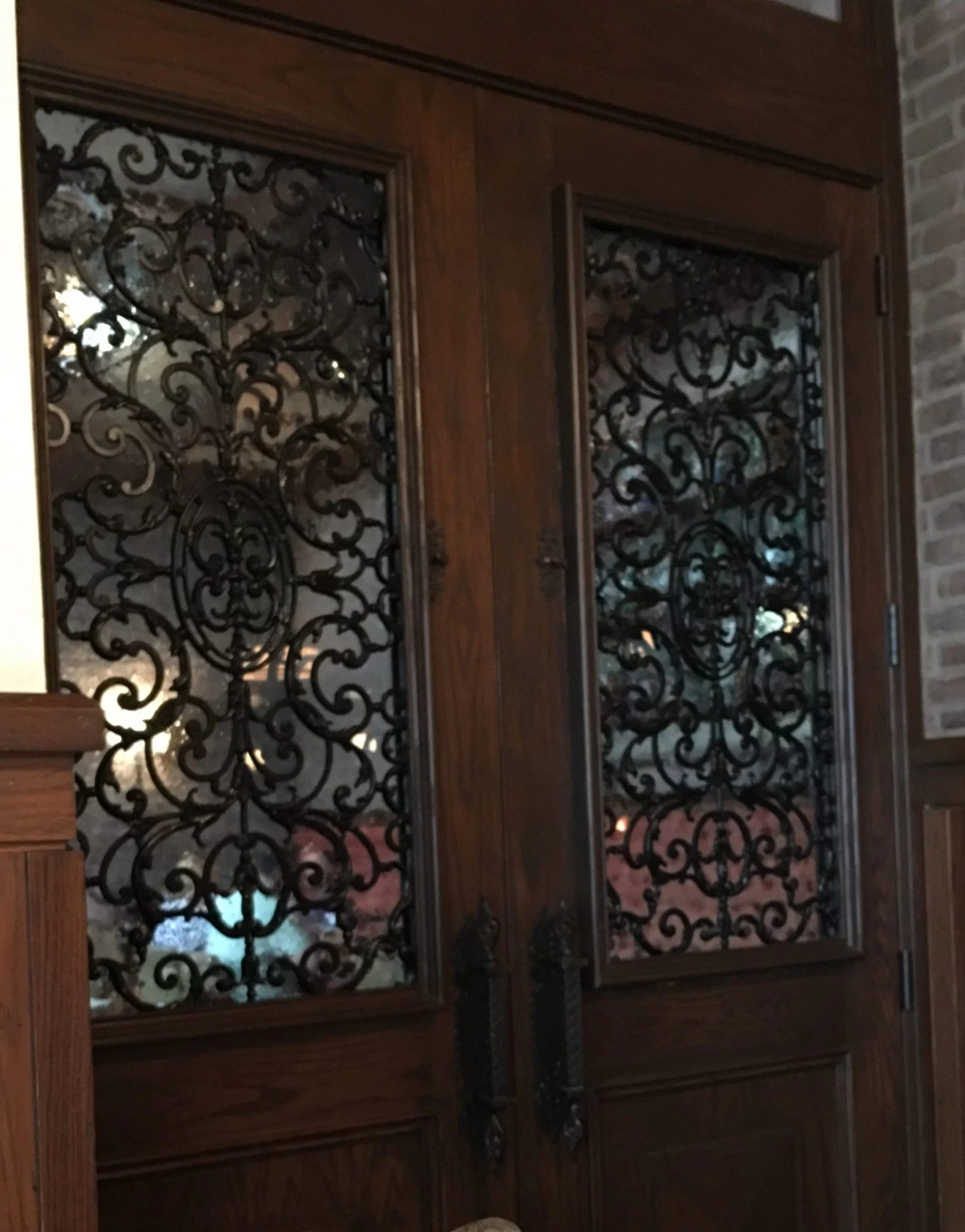 Wooden door with wrought iron at trattoria al forno wire door