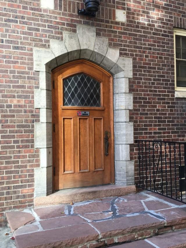 Brick exterior entrance door and window to Grosvenor Arms