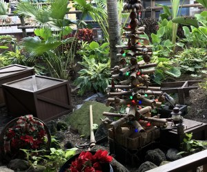 wooden christmas tree in queue at Jingle Cruise