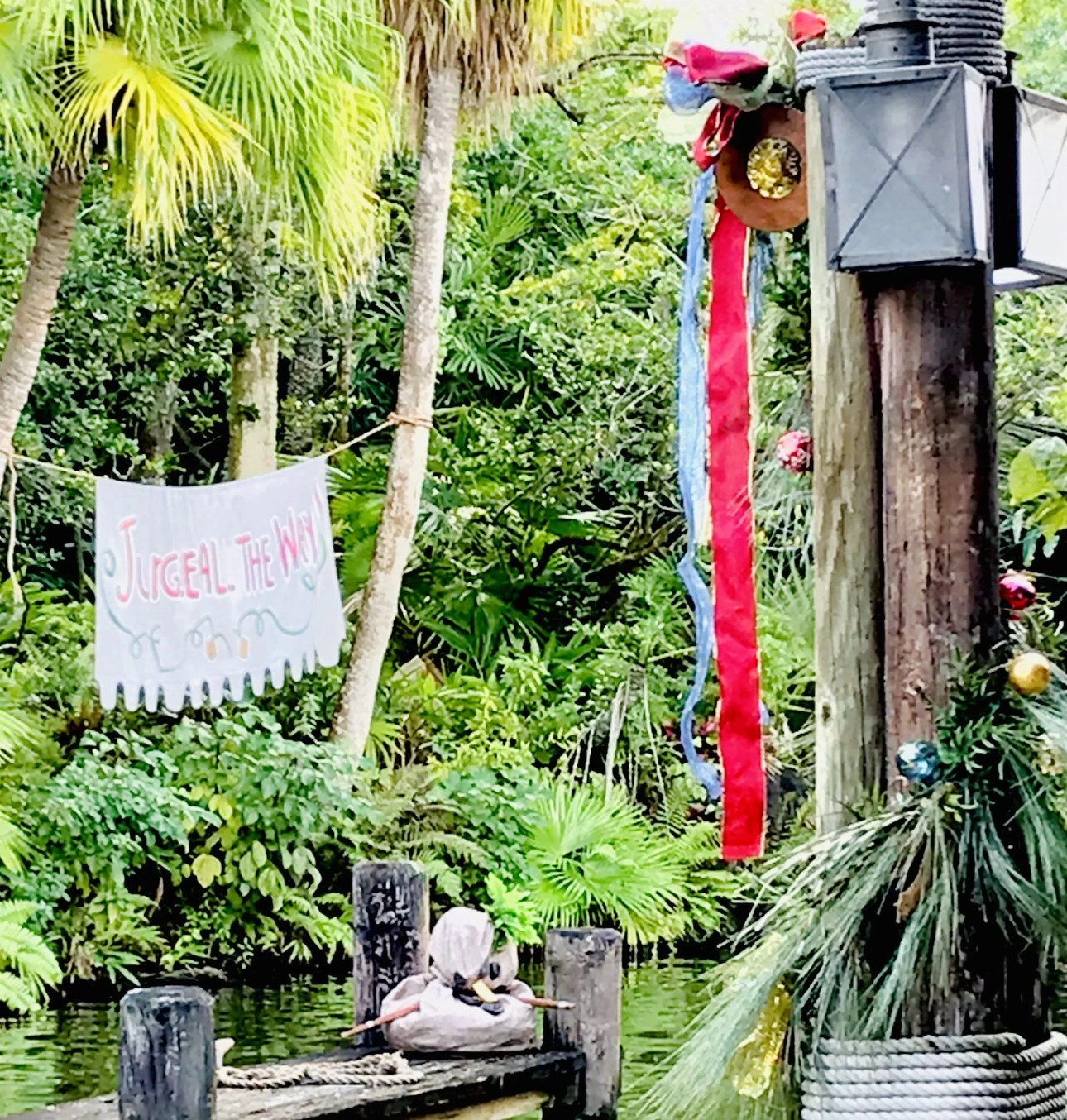 Jugeal the way on the Jingle Cruise by the docks