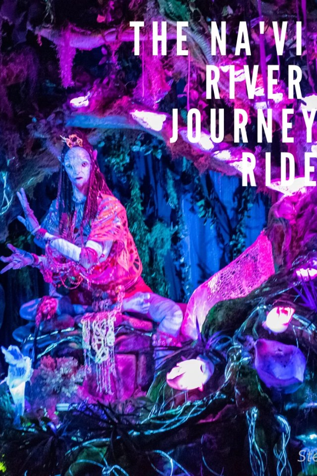 The Na'Vi River Journey Ride written over a pink and blue Shaman of Songs audio-animatronic.