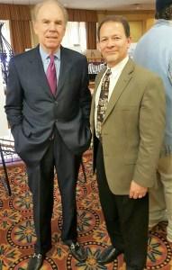 Chuck with Dallas Cowboys quarterback Roger Staubach
