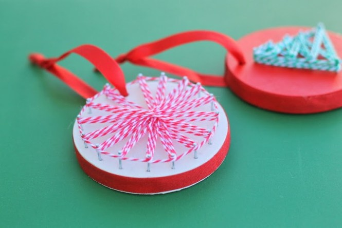 Cute Mittens Ornament A String Ball Next To Christmas Tree