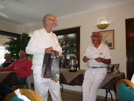 Don Roberts receiving wine as a thank you from the Bowls Group after retiring as Group Leader for 5 years