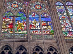 Windows in the choir of the Basilica of Saint Denis, one of the earliest uses of extensive areas of glass. (early 13th-century architecture with restored glass of the 19th-century)