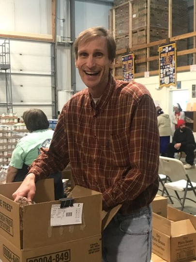 UCM Director, David Moore volunteering with UCM at the Food Bank.