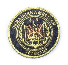 Round UUkrainian American Veterans (UAV) jacket emblem has UAV emblem embroidered in center with Ukrainian American Veterans written around perimeter